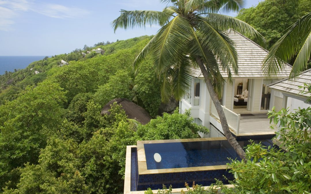 The Epitome of Early 21-st Century Island Life: Shingle Roofs Blend with Lush Tropical Flora